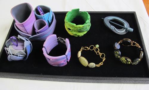 Tray of wonderfulness (bracelets, desk set and shawl pin) by Cat Szetu