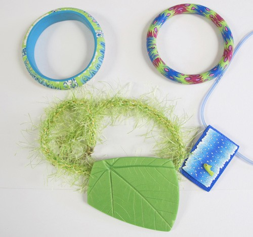 Assorted caned bracelets and necklace, impressed leaf pendant with kumihimo braiding by Deb Goodrow